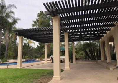 Large dark brown aluminum lattice patio cover in San Diego, CA